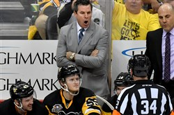 Penguins head coach Mike Sullivan argues a slashing call on Bryan Rust against the Senators during Game 5 of the Eastern Conference Finals last month.