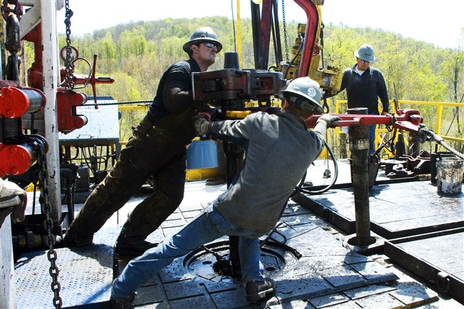 Workers move a section of well casing into place at a Chesapeake Energy natural gas well site in Bradford County in 2010. Oklahoma-based Chesapeake Energy Corp. and Texas-based Anadarko Petroleum Corp. sought to convince a Bradford County judge on Thursday to narrow or throw out a lawsuit by the state attorney general, who accuses the companies of misleading landowners about lease terms and cheating them out of royalties.