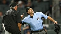 Home-plate umpire Phil Cuzzi throws manager Clint Hurdle out of the game in the fourth inning Monday.