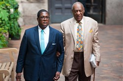 Bill Cosby is escorted from Allegheny County Courthouse after the first day of jury selection May 22.