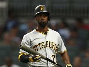 Andrew McCutchen walks back to the dugout after striking out in the third inning Tuesday at SunTrust Park.