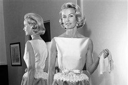 Actress and socialite Dina Merrill models the gown she went on to wear at the Academy Awards in Los Angeles in 1962. Ms. Merrill, the rebellious heiress who defied her super-rich parents to become an actress, died Monday. She was 93.