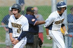 Mars' Anthony Michalski and a teammate celebrate after scoring a run Monday against Moon at North Allegheny. Mars won, 2-0.