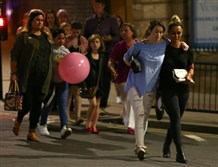 "Concertgoers leaving Manchester Arena in England after an attack Monday night. The police are treating it as a ""terrorist incident."""