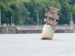 A warning sign posted on the Ohio River before Dashields lock & dam. Helene Brandy, 25, of Coraopolis, has been missing since Saturday, when her kayak went over the Dashields Dam. The body of her friend Brittany Evans, 25, of West View, was found Saturday.