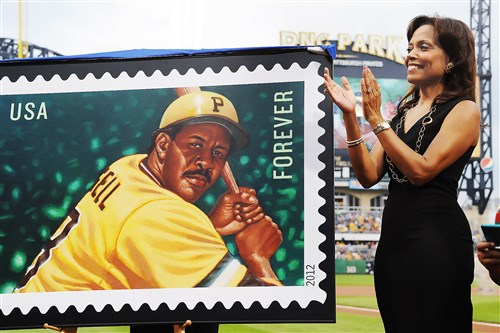Margaret Weller-Stargell, Willie Stargell's widow, stands with an image of the stamp issued by the U.S. Postal Service in 2012. Weller-Stargell's decision to auction much of Stargell's memorabilia has angered several of the Hall of Famer's children and grandchildren.