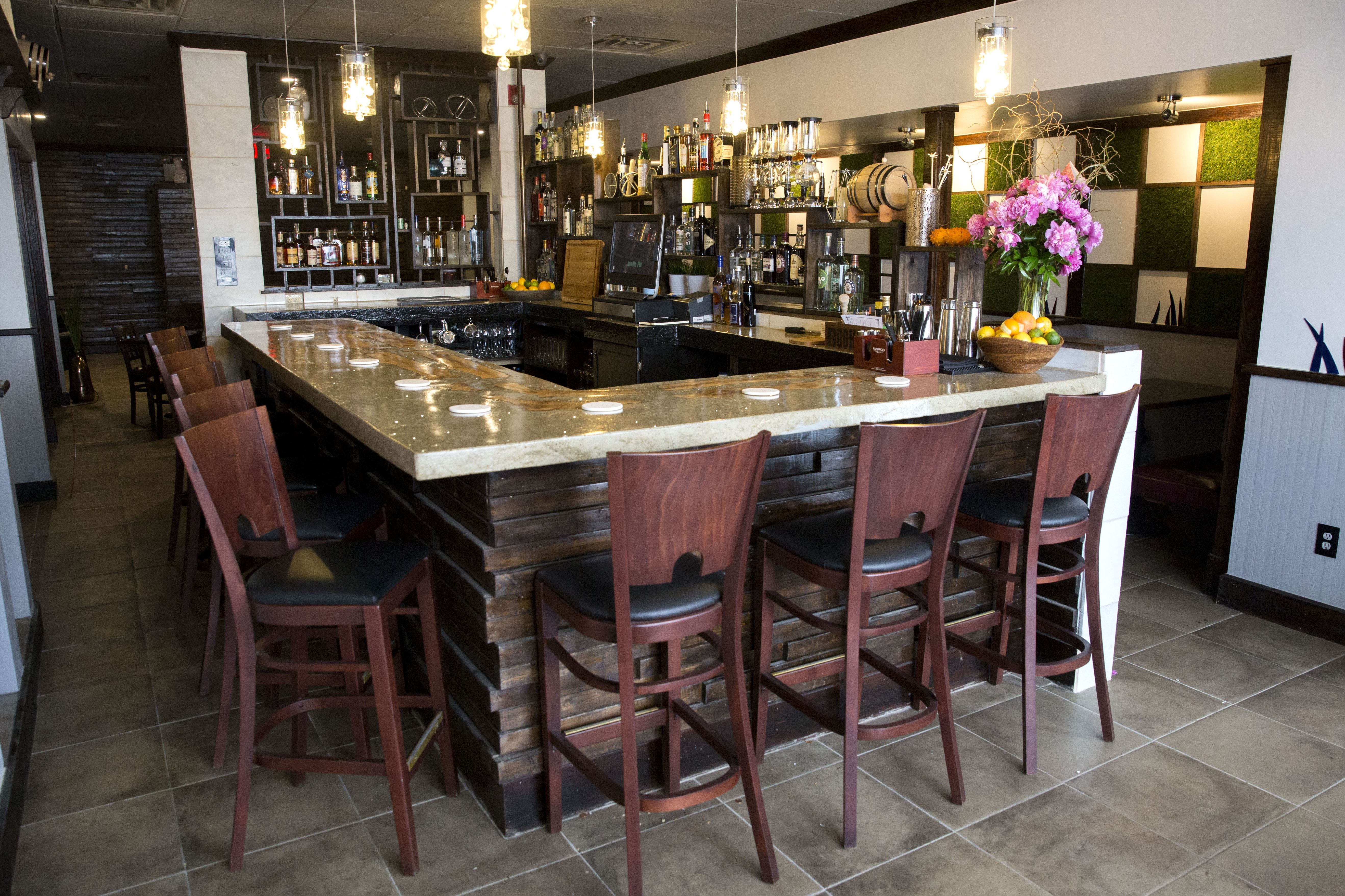 Needle pin opens with a british indian menu and 80 gins for Restaurant domont