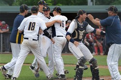 The Mars baseball team celebrates its semifinal victory against West Allegheny Wednesday. The Planets are in the WPIAL championship for the first time in school history.