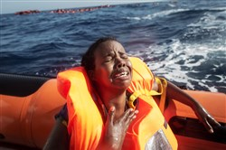 A woman in a rescue boat cries after losing her baby in the Mediterranean off Lampedusa, Italy. A boat from the Migrant Offshore Aid Station rescued her and 600 other African migrants after one of three wooden boats partially capsized, leaving more than 30 people dead.