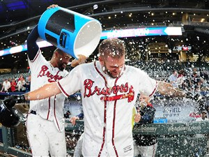 The Braves' Matt Adams is doused by Matt Kemp with the water cooler after knocking in the game-winning run in the ninth inning Wednesday morning at SunTrust Park.