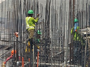 Workers standing on steel bars as they work at a construction site in Manila. Foreign steel producers on Wednesday called for prudence as the Trump administration considers possible actions to shield domestic companies from unfair imports on national security grounds. The remarks came at a public hearing as part of a Commerce Department investigation into the effects steel imports on US national security. The adminstration is similarly scrutinizing aluminum imports.