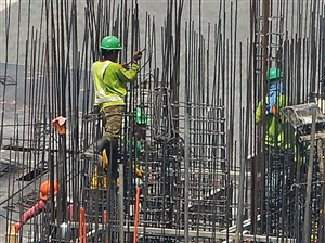 Workers standing on steel bars as they work at a construction site in Manila. Foreign steel producers on Wednesday called for prudence as the Trump administration considers possible actions to shield domestic companies from unfair imports on national security grounds.