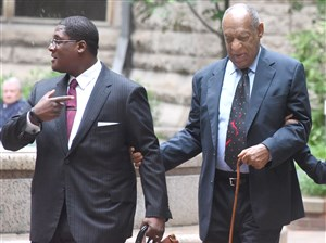 Bill Cosby is escorted into the courtyard of the Allegheny County Courthouse in Downtown Pittsburgh Wednesday morning as the third day of jury selection gets underway for the 79-year-old entertainer's sex assault trial.