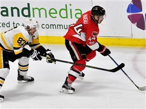 Senators Jean-Gabriel Pageau controls the puck in front of Penguins center Sidney Crosby in Game 6 of the Eastern Conference final Tuesday at Canadian Tire Centre in Ottawa, Ontario.