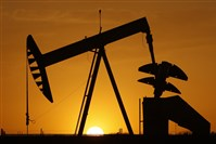 A pumpjack is silhouetted against the setting sun in Oklahoma City. With just days remaining before adjourning its 2017 session, Oklahoma lawmakers are scrambling to fill a massive hole in the budget. Negotiations have broken down over whether to increase taxes on the state's lucrative oil and gas industry.