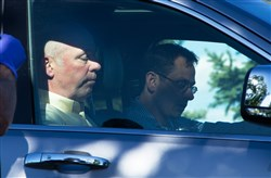 "Republican candidate for Montana's only U.S. House seat, Greg Gianforte, sits in a vehicle Wednesday in Bozeman, Mont. A reporter said Gianforte ""body-slammed"" him Wednesday, the day before the special election."