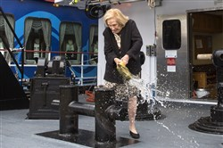 Louise H. Stephaich smashes a bottle during a rechristening ceremony for the Tommy H., a towboat named after her father, Tommy Hitchcock Jr., who served in both World Wars.