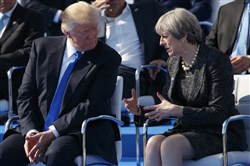 President Donald Trump talks with British Prime Minister Theresa May during a ceremony at the new NATO headquarters Thursday in Brussels.