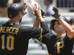 The Pirates' Adam Frazier is congratulated by Jordy Mercer after hitting a three-run home run against the Atlanta Braves in the second inning Thursday in Atlanta.