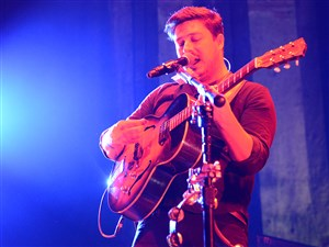 Marcus Mumford and Ben Lovett, left, of Mumford & Sons perform Wednesday at KeyBank Pavilion in Burgettstown, Washington County.