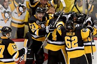 Penguins teammates congratulate Chris Kunitz after he scored the game-winning goal against the Senators in the second overtime of Game 7 of the Eastern Conference final Thursday, May 25, 2017, at PPG Paints Arena.