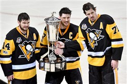 Sidney Crosby, center, and Evgeni Malkin, right, are having another memorable postseason.