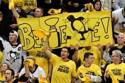 Penguins fans cheer on their team against the Senators in the third period of game 7 of the Eastern Conference Finals Thursday, May 25, 2017, at PPG Paints Arena.