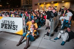 Fans watched the Penguins play the Senators in Game 7 of the Stanley Cup Playoffs' NHL Eastern Conference Finals outside PPG Paints Arena on Thursday in Uptown.