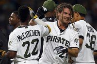 The Pirates' John Jaso celebrates with teammates after roping a walk-off single to right field off left-hander Josh Edgin in the 10th inning as the Pirates evened the series with a 5-4 come-from-behind win.