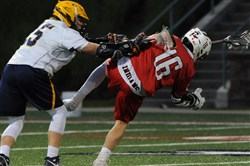 Mt. Lebanon's Connor Brumfield, left, shoves Peters Township's Zach Gramling in the WPIAL Class 3A boys lacrosse championship May 26 at Robert Morris University.