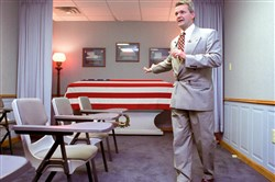 William Zwicharowski, mortuary branch chief at Dover Air Force Base in Delaware, talks with the press during a tour of the mortuary in 2003.