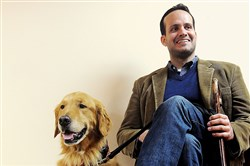 Former Army Capt. Luis Carlos Montalvan during an appearance at Mt. Lebanon Library in April 2013 with his golden retriever Tuesday.
