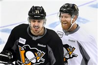 Evgeni Malkin shares a laugh with Patric Hornqvist during practice Sunday at PPG Paints Arena.