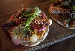 The Tako taco includes grilled octopus, harissa aioli, preserved lemons, mizuna greens and herbs and pickled red onion.