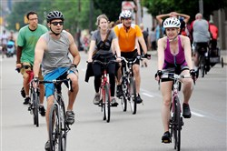 Cyclists and walkers make their way along Forbes Avenue on Sunday during OpenStreetsPGH.