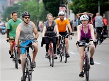 Cyclists and walkers make there way down Forbes Avenue during OpenStreetsPGH in May.