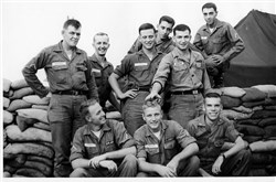 Standing: Butch Curtiss, Joe Moraski, Dale Dowd, Marty Gabel, Bob Harbatkin and Bob Falletta. Sitting: Terry Raney, Ken Hartman and Ed Blank. The photograph was taken in Long Binh, Vietnam, on Oct. 29, 1966.