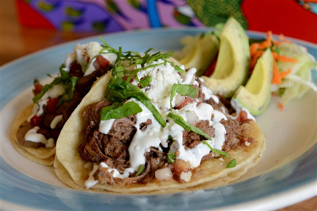 A Barbacoa (steamed and shredded beef) taco by La Palapa, Mexican Gourmet Kitchen on the South Side.