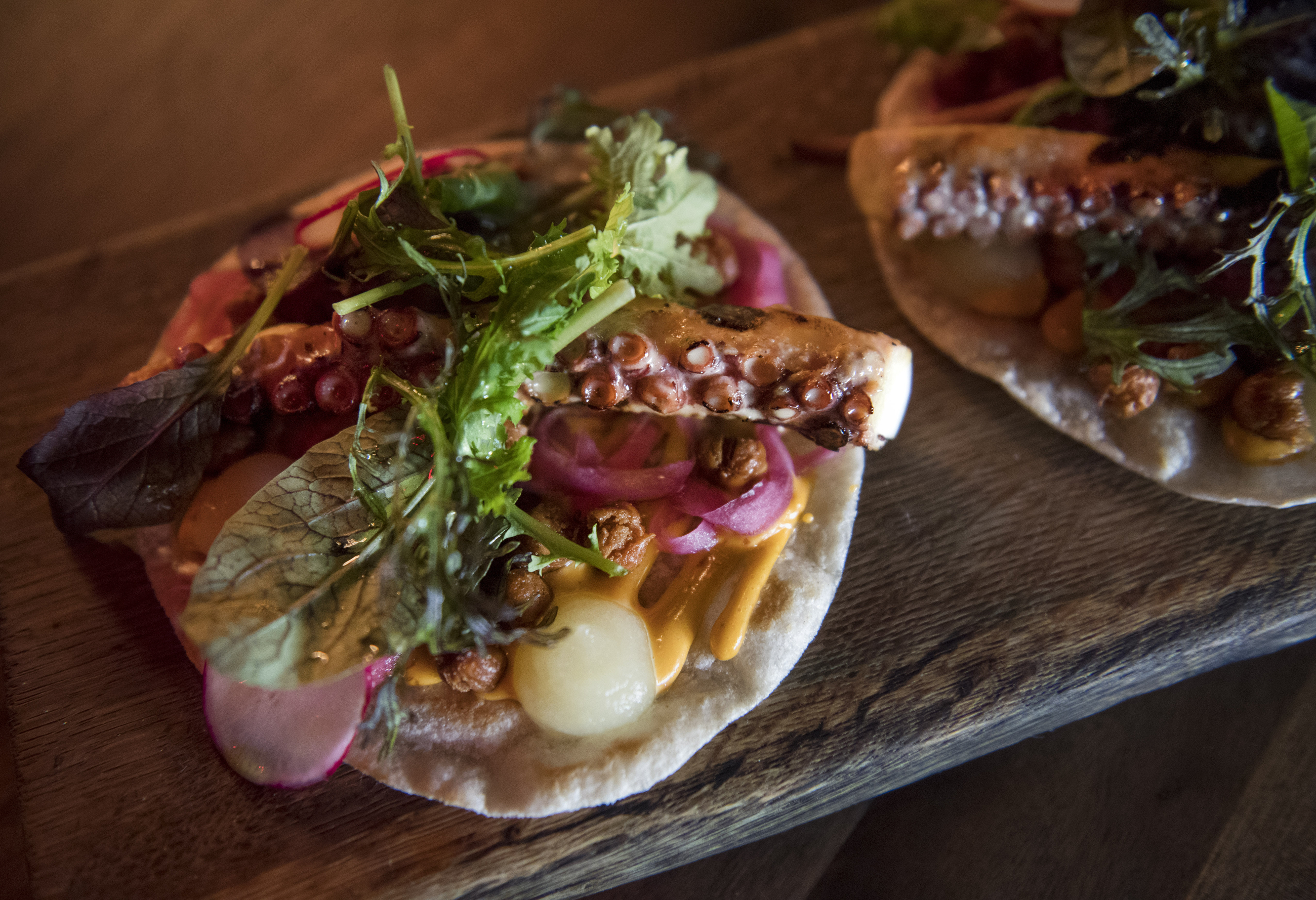 20170523scTako01 The Tako taco, which includes grilled octopus, harissa aioli, preserved lemons, mizuna greens & herbs and pickled red onion, is photographed on Tuesday, May 23, 2017 at Tako downtown.
