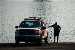 Members of the Ambridge Fire Department pull their boat from the Ohio River at the Leetsdale Boat Ramp after removing the body of a white female in a bathing suit on Sunday in Leetsdale. The body was found on the Aliquippa side of the river at approximately 3:30 p.m. The Ambridge Fire Department and the Fish and Game Commission originally spotted the body.