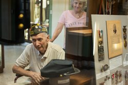"""Janet Interthao, right, 64, of Ross Township, looks at military objects with her father, World War II Navy veteran Bernie Stephan, 88, of Millville, as they celebrate Memorial Day together on Monday at Soldiers & Sailors Memorial Hall and Museum in Oakland. """"He's a real history buff and he's real proud of being in the war and serving his country,"""" said Ms. Interthao of her father. The pair visits Soldiers & Sailors most years to mark the holiday, but last year they celebrated in Washington, D.C., where Mr. Stephan was invited to place the ceremonial wreath at the World War II monument for the Navy."""