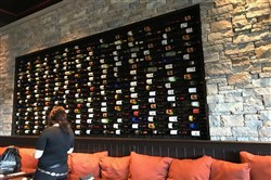 The wine wall at Firebirds Wood Fired Grill has domestic and international bottles.