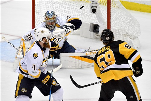 Jake Guentzel scores the winning goal on Predators goaltender Pekka Rinne in the third period of Game 1 of the Stanley Cup final Monday at PPG Paints Arena.