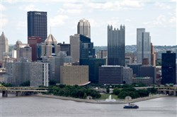 A Gateway Clipper ship approaches the Point as it passes in front of the Pittsburgh downtown skyline.