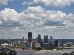 Clouds hang over the Downtown skyline. But who in the region gets to call this view their own?