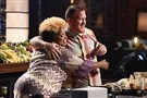 "Yachecia Holston embraces fellow pastor Shawn Niles after their fried chicken cook-off on Fox's ""MasterChef."""