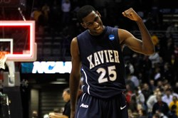 Dante Jackson celebrates after defeating Pitt during the second round of the 2010 NCAA men's basketball tournament.