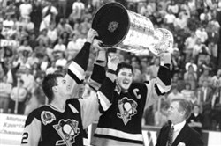 Alternate captain Bob Errey watches Mario Lemieux hoist the Cup after the Penguins' victory over the Minnesota North Stars in 1991.