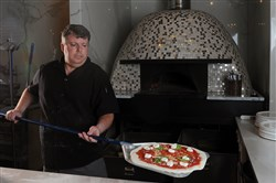 Ron Molinaro, executive chef and owner of Il Pizzaiolo in Glenshaw, prepares a high-quality, Neapolitan-style pizza in his restaurant.