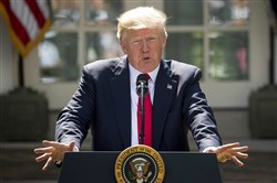 President Donald Trump speaks about the U.S. role in the Paris climate change accord, Thursday outside the White House.
